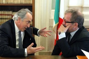 abetePresident of the Italian Soccer Federation (FIGC) Giancarlo Abete, left, talks to Italian Interior Minister Roberto Maroni during a meeting to discuss the probe on Italy's soccer match-fixing scandal, in Rome, Friday, June 10, 2011.