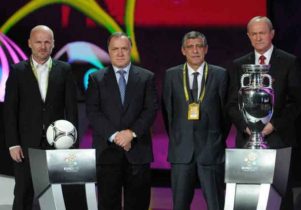 The four Group A coaches (L-R) Czech Republic's manager Michal Bilek, Russia's manager Dick Advocaat, Greece's manager Fernando Santos and Poland's manager Franciszek Smuda pose after the draw ceremony of the Euro 2012 football championships at the National Palace of Arts in Kiev on December 2, 2011.
